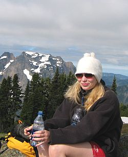 Jamie in Sunglasses resting on the summit of Mt. Dickerman in the western Cascades